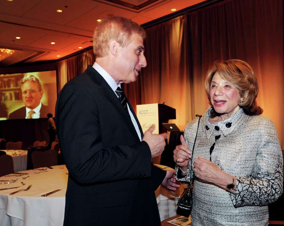 Robert Bazell, left, chief science and health correspondent for NBC News, speaks with Barbara Netter of Greenwich during the Alliance for Cancer Gene Therapy's 10th anniversary celebration at Hyatt Regency Greenwich, Thursday, April 19, 2012.  Netter along with her husband Edward, founded the nonprofit organization, ACGT, that has raised millions for innovative cancer research and treatments. Photo: Bob Luckey / Greenwich Time