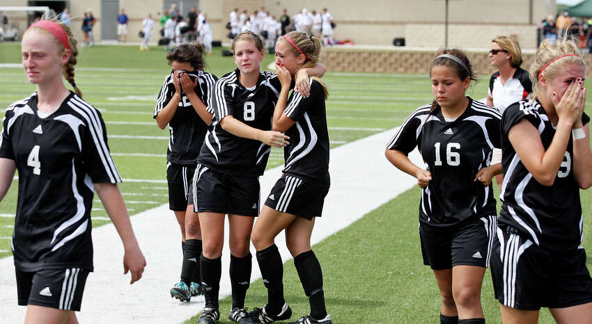 Members of the Churchill Chargers are dejected after their Class 5A state semifinal game with Katy Seven Lakes Thursday, April 19, 2012 at Birkelbach Field in Georgetown. Katy Seven Lakes defeated Churchill 2-1 in a shootout.