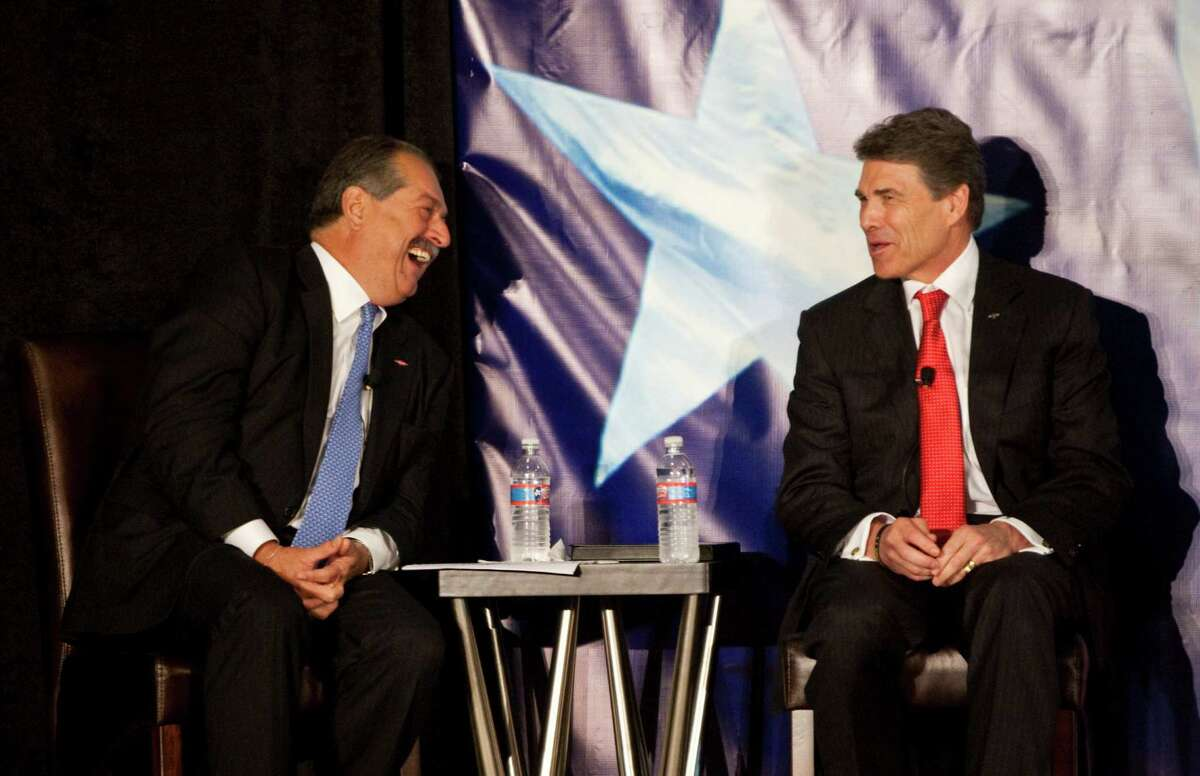 Dow Chemical Co. chairman and CEO Andrew Liveris, left, and Texas Gov. Rick Perry were in Lake Jackson on Thursday for Dow's expansion announcement.
