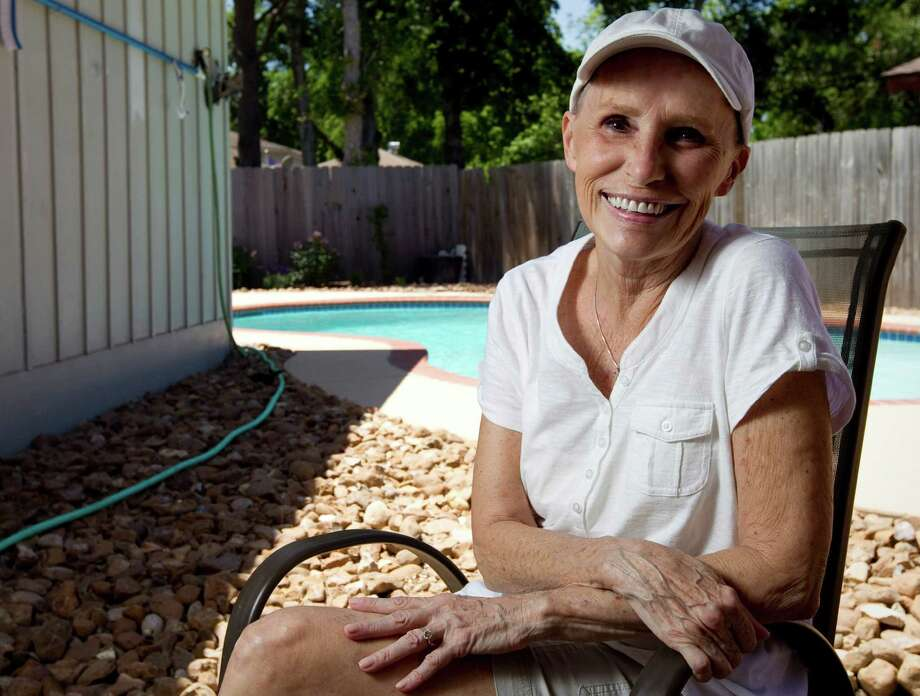 Merrily Chisholm, of Sugar Land, says pain got worse with every cancer treatment until she got a nerve stimulation implant. Photo: Nick De La Torre / © 2012  Houston Chronicle