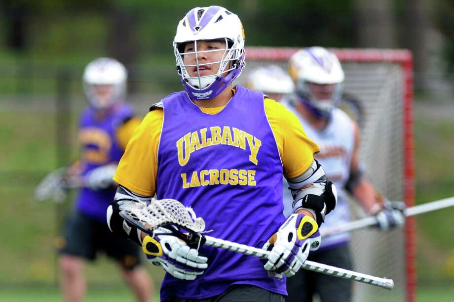 Lacrosse player Miles Thompson (2), center, during practice on Tuesday, April 17, 2012, at UAlbany in Albany, N.Y. (Cindy Schultz / Times Union) Photo: Cindy Schultz / 00017267A
