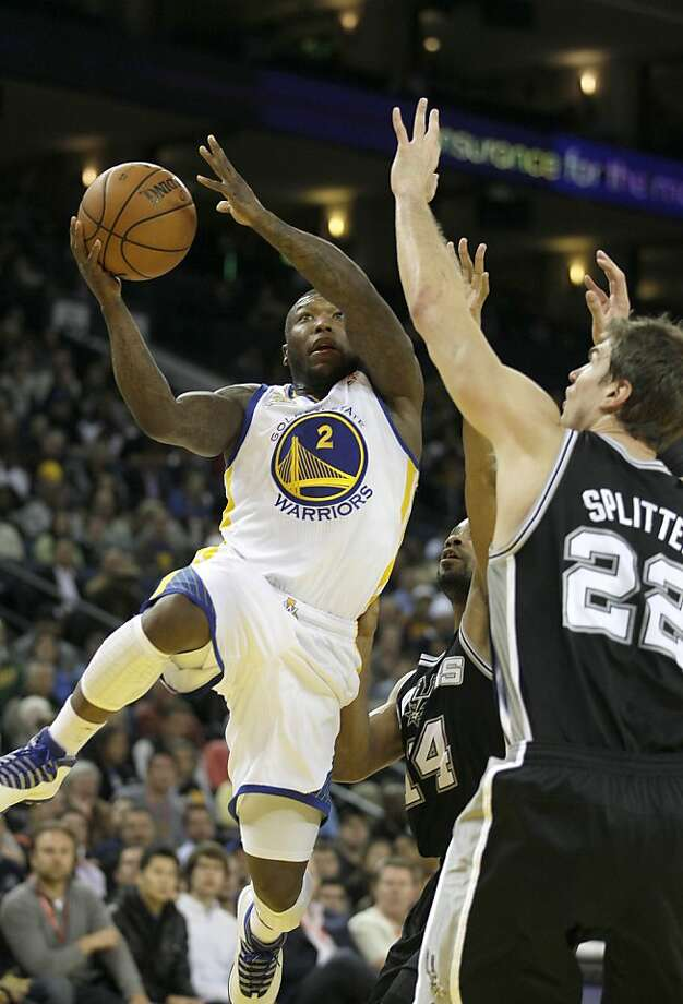 Golden State Warriors point guard Nate Robinson (2) against San Antonio Spurs center Tiago Splitter (22), from Brazil, during an NBA basketball game in Oakland, Calif., Monday, April 16, 2012. (AP Photo/Jeff Chiu) Photo: Jeff Chiu, Associated Press