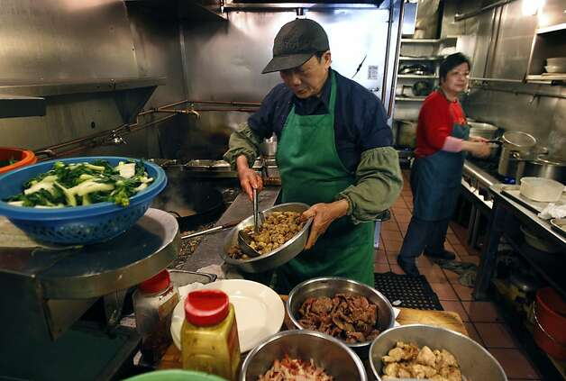 Sen Ren Situ cooks up a lunch order in the cramped kitchen of Chinatown's legendary Sam Wo restaurant in San Francisco, Calif. on Thursday, April 19, 2012. The restaurant's owner is closing its doors for good on Friday. Photo: Paul Chinn, The Chronicle