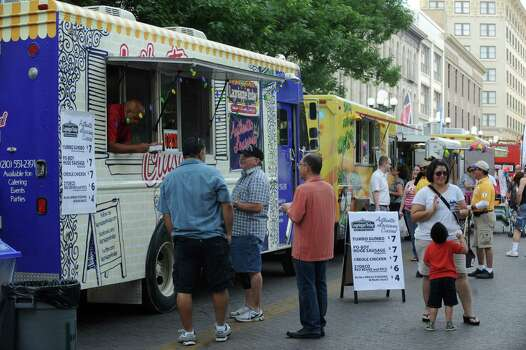 Food trucks and trailers are lined up on Alamo Street to serve customers during Fiesta 2012 opening festivities in Alamo Plaza on Thursday, April 19, 2012. Billy Calzada / San Antonio Express-News Photo: BILLY CALZADA, SAN ANTONIO EXPRESS-NEWS / San Antonio Express-News