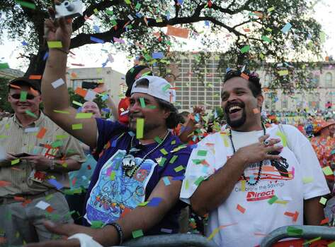 Ruben Gonzales, left, and Naser Cuchillas celebrate during Fiesta 2012 opening festivities in Alamo Plaza on Thursday, April 19, 2012. Billy Calzada / San Antonio Express-News Photo: BILLY CALZADA, SAN ANTONIO EXPRESS-NEWS / San Antonio Express-News