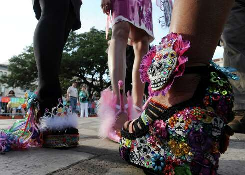 Winners in the Fiesta 2012 ¡Viva! Zapatos contest for Fiesta wear their decorative shoes during Fiesta 2012 opening festivities in Alamo Plaza on Thursday, April 19, 2012. Billy Calzada / San Antonio Express-News Photo: BILLY CALZADA, SAN ANTONIO EXPRESS-NEWS / San Antonio Express-News