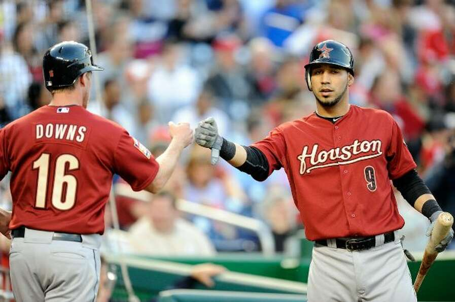 Matt Downs of the Astros celebrates with Marwin Gonzalez after scoring in the first inning. (Greg Fi