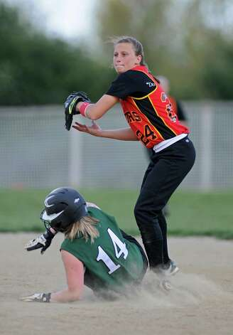 Mechanicville shortstop Alysa Russell forces Schalmont's Tori VanAlstyne at second, during Mechanicville's victory on Thursday April 19, 2012 in Mechanicville, NY.  (Philip Kamrass / Times Union ) Photo: Philip Kamrass / 00017289A