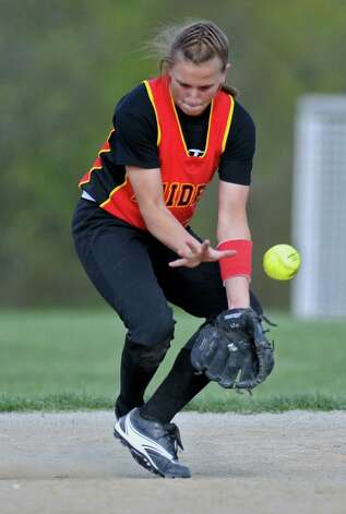 A grounder gets past Mechanicville shortstop Alysa Russell during their victory over Schalmont on Thursday April 19, 2012 in Mechanicville, NY.  (Philip Kamrass / Times Union ) Photo: Philip Kamrass / 00017289A