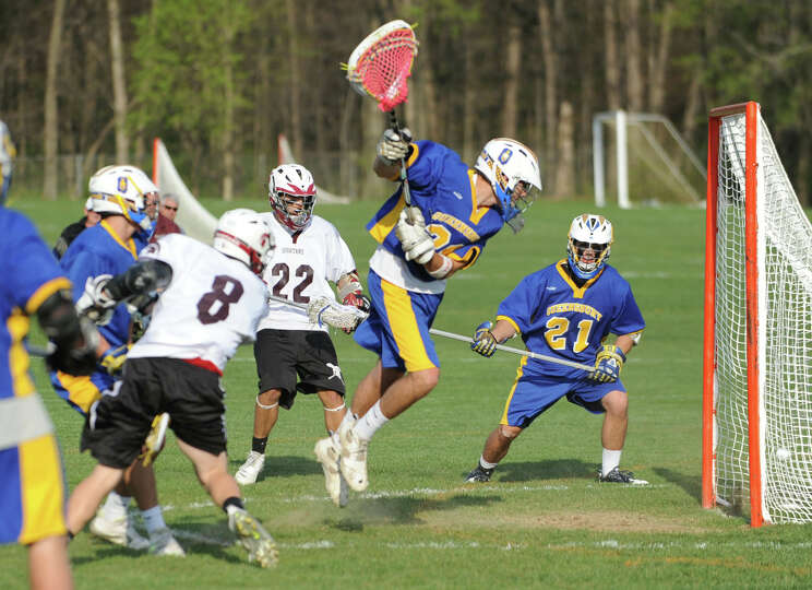 Austin Clark of Burnt Hills scores against Queensbury during a lacrosse game on April 19, 2012 in Bu