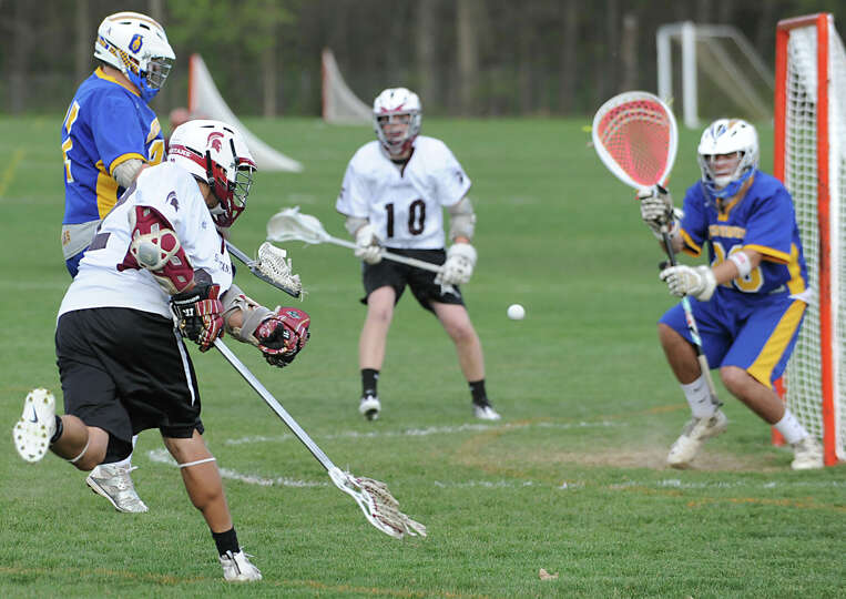 Trevor Hiss of Burnt Hills takes a shot at the net and scores during a lacrosse game against Queensb