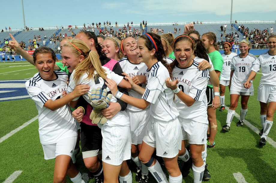 Seven Lakes players including, front from left, Kellie Johnston, Sarah Eads, Siobhan Higgins and Peyton Sanders, celebrate their shootout win over San Antonio Churchill that put them in Saturday's state final. Photo: Jerry Baker