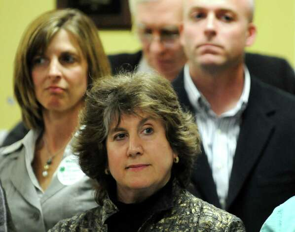 Mona Golub, center, listens to the redevelopment plan for the St. Patrick's Church property on Thursday, April 19, 2012, at the Watervliet Senior Center in Watervliet, N.Y. (Cindy Schultz / Times Union) Photo: Cindy Schultz / 00017312A