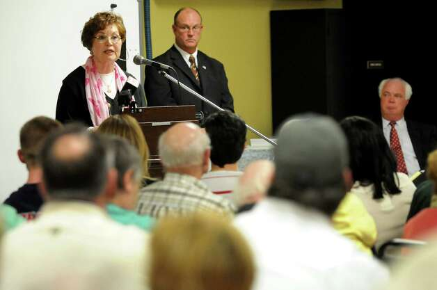 City resident Eileen Anderson, left, comments on the redevelopment plan for the St. Patrick's Church property on Thursday, April 19, 2012, at the Watervliet Senior Center in Watervliet, N.Y. (Cindy Schultz / Times Union) Photo: Cindy Schultz / 00017312A