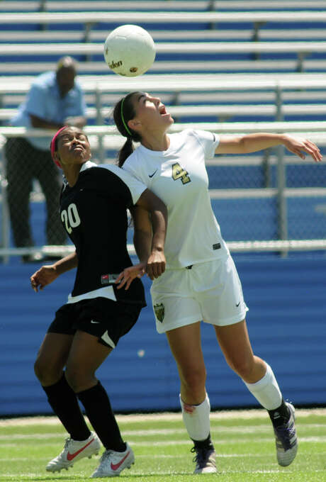 Klein Oak midfielder Julia Swartzenberg, right, battles Plano West forward Logan Beal. Photo: Jerry Baker