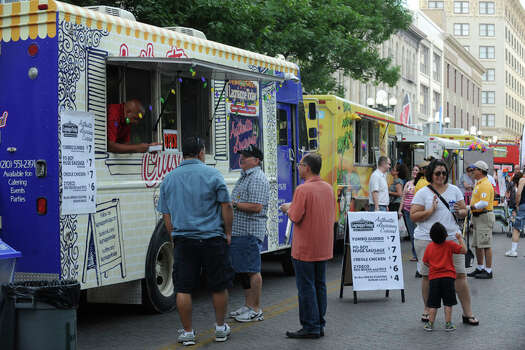 Food trucks and trailers are lined up on Alamo Street to serve customers during Fiesta 2012 opening festivities in Alamo Plaza on April 19, 2012. Photo: BILLY CALZADA,  Billy Calzada / San Antonio Express-News / San Antonio Express-News