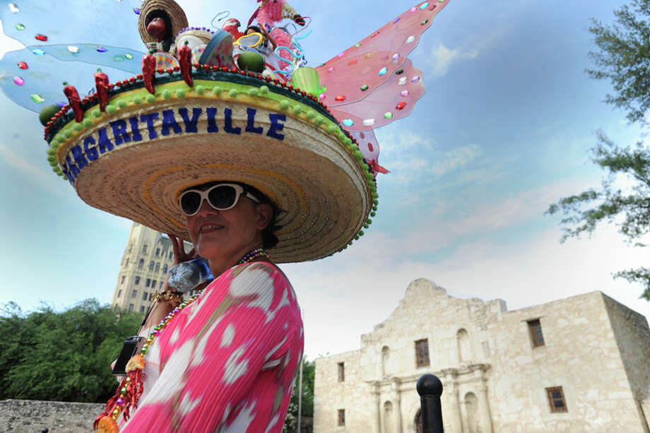 Paulene Grossman wears her festive hat next to the Alamo shrine during Fiesta 2012 opening festivities in Alamo Plaza on April 19, 2012. Photo: BILLY CALZADA,  Billy Calzada / San Antonio Express-News / San Antonio Express-News