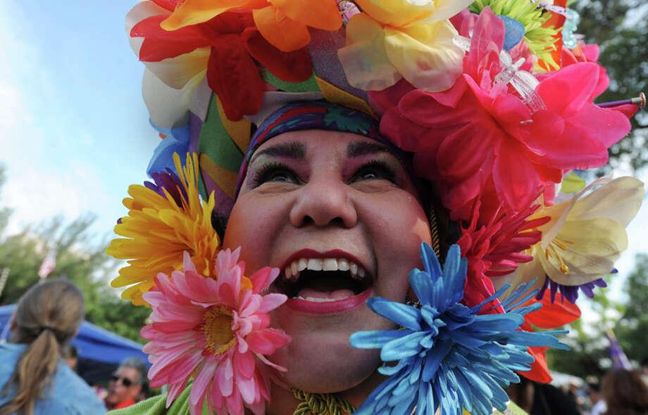 "Minu Martinez wears her decorative hat during Fiesta 2012 opening festivities in Alamo Plaza on April 19, 2012. ""It's Minu,"" she said, ""not Manu."" Photo: BILLY CALZADA,  Billy Calzada / San Antonio Express-News / San Antonio Express-News"