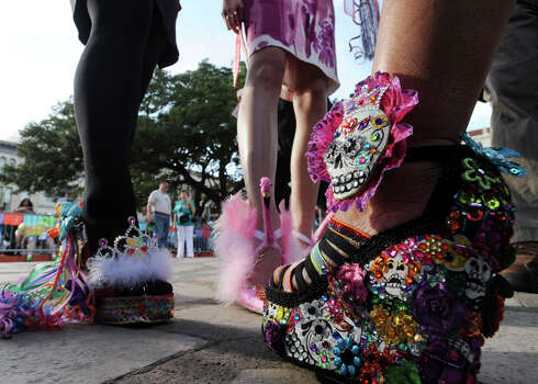 Winners in the Fiesta 2012 Viva! Zapatos contest for Fiesta wear their decorative shoes during Fiesta 2012 opening festivities in Alamo Plaza on April 19, 2012.Billy Calzada / San Antonio Express-News Photo: BILLY CALZADA,  Billy Calzada / San Antonio Express-News / San Antonio Express-News