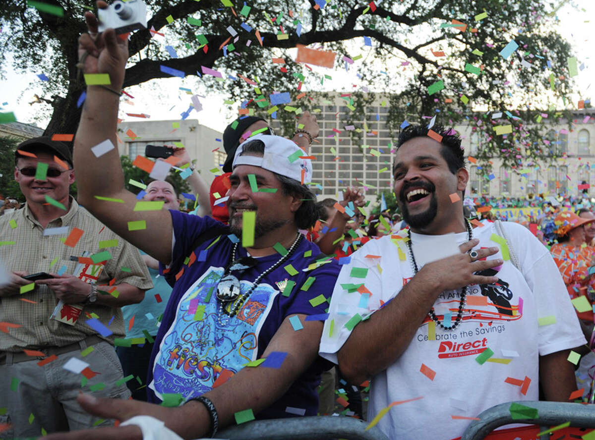 Ruben Gonzales, left, and Naser Cuchillas celebrate during Fiesta 2012 opening festivities in Alamo Plaza on April 19, 2012.