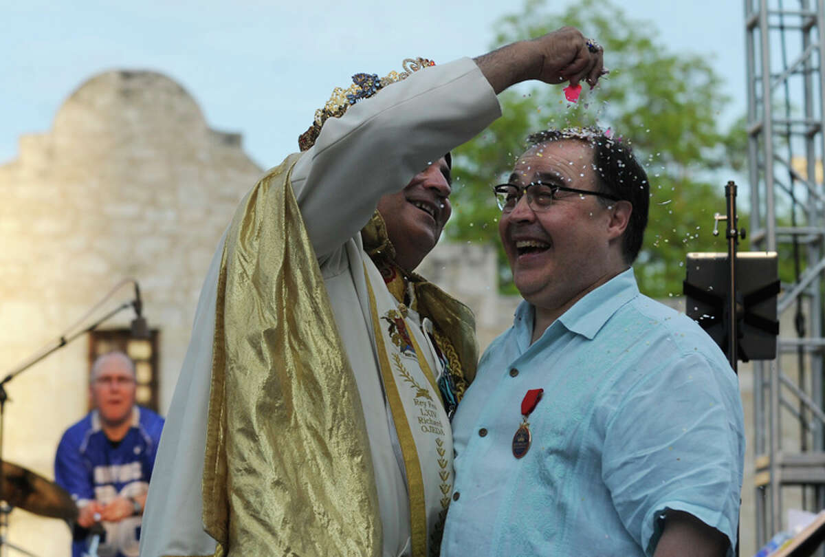 Rey Feo LXIV Richard Ojeda (left) cracks a cascaron on the head of Ramiro Cavazos, CEO and president of the San Antonio Hispanic Chamber of Commerce, during Fiesta 2012 opening festivities in Alamo Plaza on April 19, 2012.