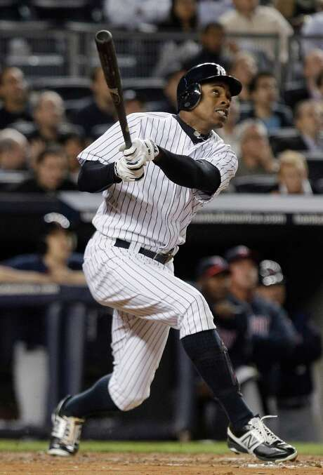 It's two down and out, one to go for Curtis Granderson as he hits his second homer in the second inning. Photo: Frank Franklin II / AP