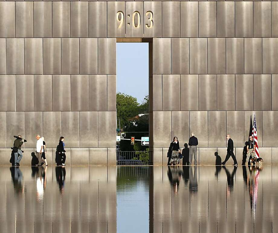 People walk at the Oklahoma City National Memorial and Museum before the start of the 17th annual remembrance ceremony in Oklahoma City, Thursday, April 19, 2012.  Timothy McVeigh was convicted on federal murder charges for the 1995 deadly bombing and was executed in 2001. The bombing was the deadliest terrorist attack on U.S. soil before the 9/11 attacks.  (AP Photo/Sue Ogrocki) Photo: Sue Ogrocki, Associated Press
