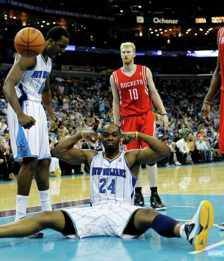 Carl Landry (24) didn't sit on his laurels, instead leading the Hornets' second-half rally and overtime surge to bring down his former team Thursday night. Landry's 20 points and 10 rebounds helped deal the Rockets' playoff hopes a lethal blow. Photo: Gerald Herbert / AP