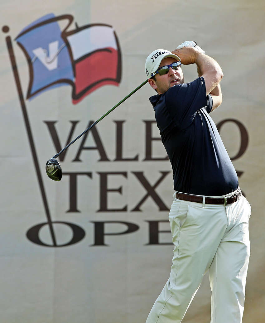 Ben Curtis tees off on the No. 18 hole during the first round of the 2012 Valero Texas Open on Thursday, April 19, 2012.