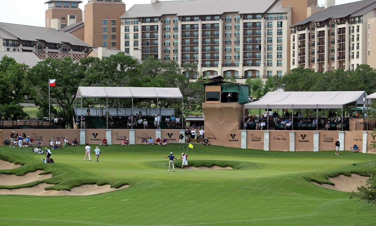 Players finish on the No. 16 green during the first round of the 2012 Valero Texas Open on Thursday, April 19, 2012.