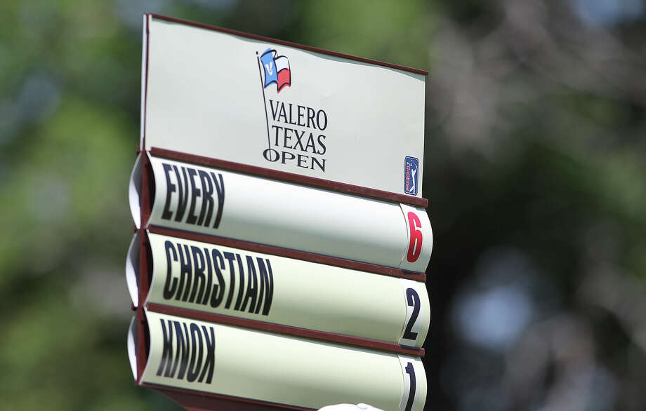 A standard shows a complete sentence during first round of the 2012 Valero Texas Open on Thursday, April 19, 2012. Photo: TOM REEL, San Antonio Express-News / San Antonio Express-News