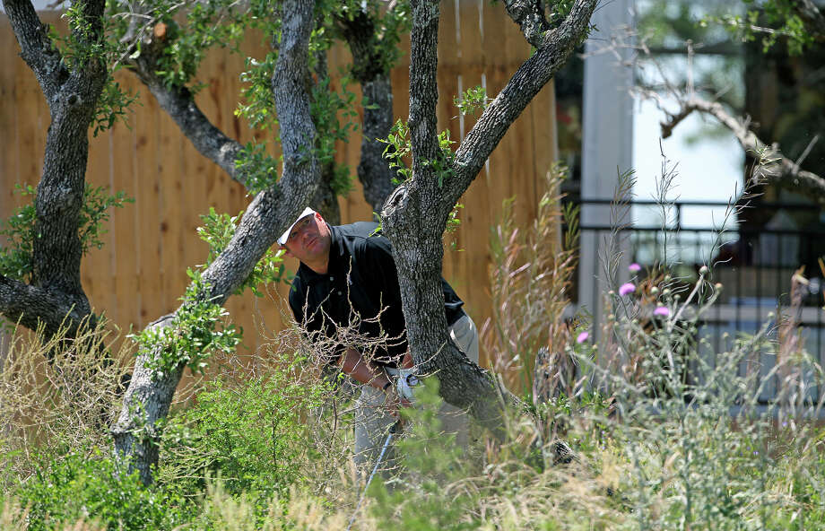 Jason Gore follows his second shot after punching out of jail on the right side of the No. 18 fairway during the first round of the 2012 Valero Texas Open on Thursday, April 19, 2012. Photo: TOM REEL, San Antonio Express-News / San Antonio Express-News