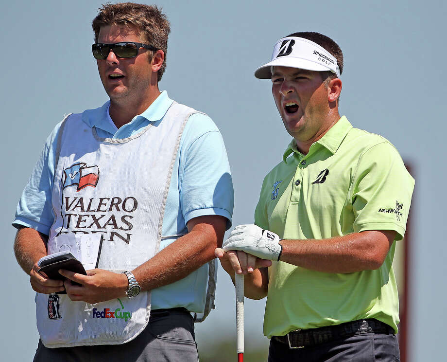 Matt Every yawns as his caddy studies the card on the No. 4 tee box during the first round of the 2012 Valero Texas Open on Thursday, April 19, 2012. Photo: TOM REEL, San Antonio Express-News / San Antonio Express-News