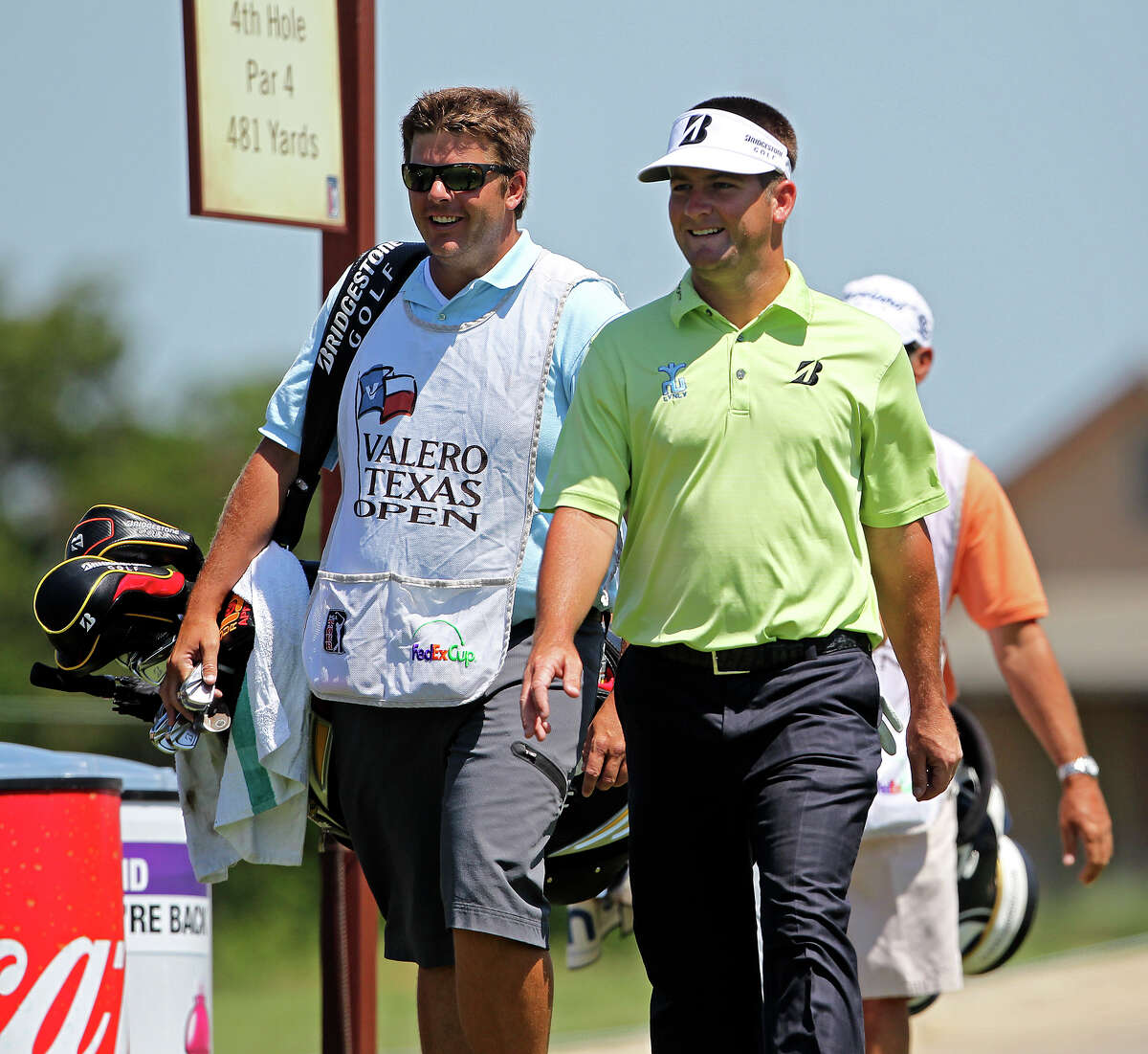 Matt Every (right) is all smiles making his way to the No. 4 tee box during Thursday's first round.