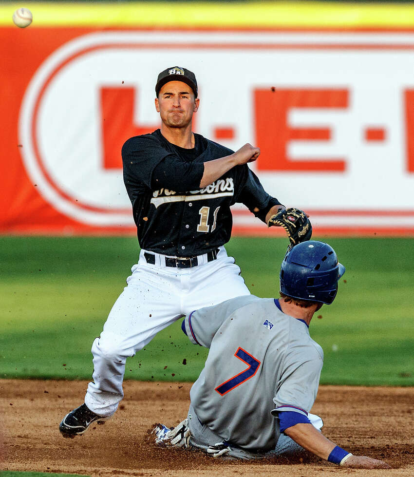 Missions second baseman Dean Anna throws to first as Midland's Dusty Coleman slides into second during their game at Wolff Stadium on Thursday, April 19, 2012. Midland came away with a 4-1 victory.