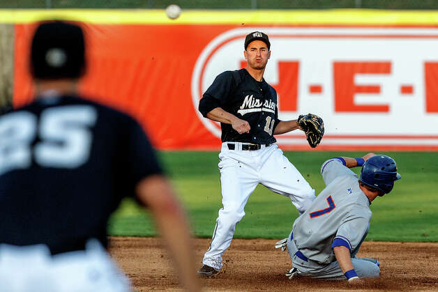 Missions second baseman Dean Anna watches his throws to Nate Freiman at first as Midland's Dusty Coleman slides into second during their game at Wolff Stadium on Thursday, April 19, 2012. Midland came away with a 4-1 victory. Photo: Marvin Pfeiffer, San Antonio Express-News