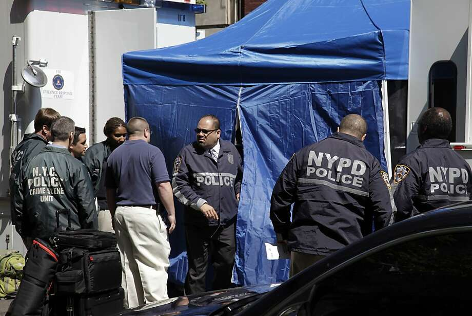 FBI and NYPD law enforcement officials search a SoHo basement at the corner of Wooster and Prince streets for the possible remains of missing child Etan Patz on Thursday, April 19, 2012 in New York. Patz vanished in 1979 after leaving his family's SoHo home for a short walk to his school bus stop.  NYPD spokesman Paul Browne says the building being searched is about a block from where the family lived. Photo: Bebeto Matthews, Associated Press