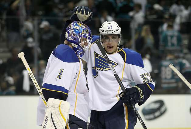 David Perron #57 congratulates Brian Elliott #1 of the St. Louis Blues after they beat the San Jose Sharks in Game Four of the Western Conference Quarterfinals during the 2012 NHL Stanley Cup Playoffs at HP Pavilion on April 19, 2012 in San Jose, California. Photo: Ezra Shaw, Getty Images