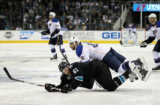 Scott Nichol #12 of the St. Louis Blues collides with Justin Braun #61 of the San Jose Sharks in the second period of Game Four of the Western Conference Quarterfinals during the 2012 NHL Stanley Cup Playoffs at HP Pavilion on April 19, 2012 in San Jose, California. Photo: Ezra Shaw, Getty Images