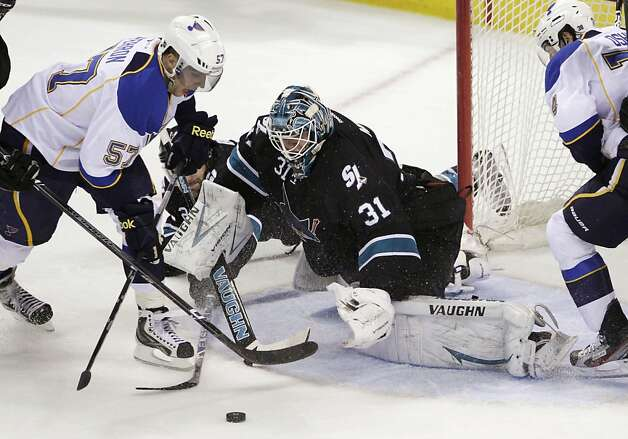 St. Louis Blues left wing David Perron (57) is unable to score past San Jose Sharks goalie Antti Niemi (31), of Finland, during the first period in Game 4 of an NHL Stanley Cup first-round hockey playoff series Thursday, April 19, 2012, in San Jose, Calif. Photo: Paul Sakuma, Associated Press