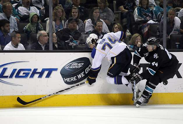 T.J. Oshie #74 of the St. Louis Blues tries to avoid being hit by Marc-Edouard Vlasic #44 of the San Jose Sharks in Game Four of the Western Conference Quarterfinals during the 2012 NHL Stanley Cup Playoffs at HP Pavilion on April 19, 2012 in San Jose, California. Photo: Ezra Shaw, Getty Images