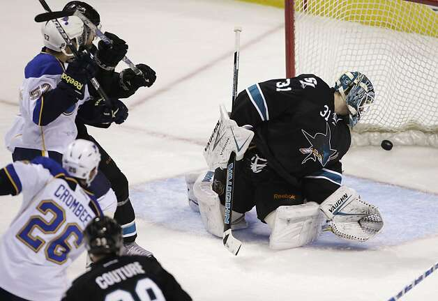 St. Louis Blues right wing B.J. Crombeen (26) scores past San Jose Sharks goalie Antti Niemi (31), of Finland, during the first period in Game 4 of an NHL Stanley Cup first-round hockey playoff series Thursday, April 19, 2012, in San Jose, Calif. Photo: Paul Sakuma, Associated Press