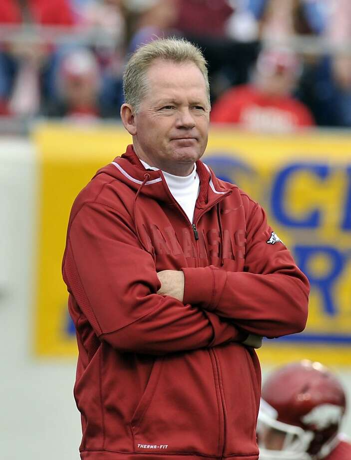 Arkansas has fired Bobby Petrino, seen during a warmups before the Arkansas Razorbacks faced the Mississippi State Bulldogs at War Memorial Stadium in Little Rock, Arkansas, saying he ''knowingly misled'' and engaged in reckless behavior in a relationship with a female football employee half his age. The 51-year-old Petrino was injured in an April 1 motorcycle accident. He was put on paid leave last week after admitting he lied about the presence of the 25-year-old employee, Jessica Dorrell, who had been riding with him. Razorbacks play the Mississippi State Bulldogs at War Memorial Stadium in Little Rock, Arkansas. (Jimmy Jones/Zuma Press/MCT) Photo: Jimmy Jones, McClatchy-Tribune News Service