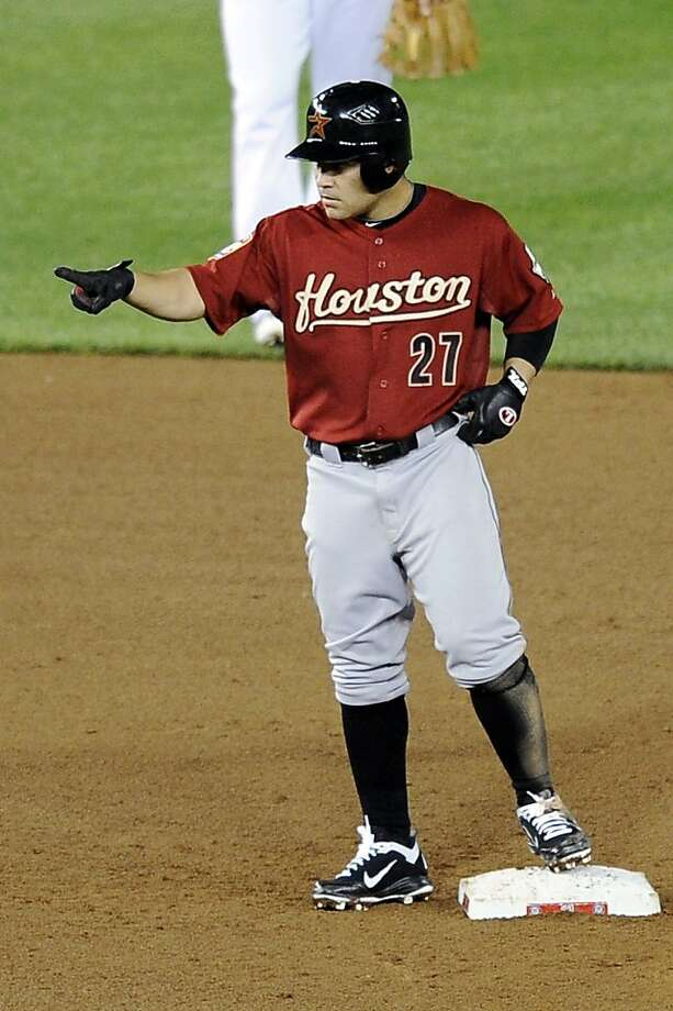 Houston Astros' Jose Altuve (27) points after he doubled in two runs during the sixth inning of a baseball game against the Washington Nationals, Thursday, April 19, 2012, in Washington. The Astros won 11-4. (AP Photo/Nick Wass) Photo: Nick Wass, Associated Press