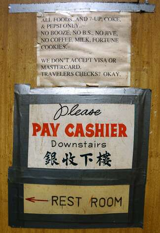 Signs taped to the walls decades ago remain undisturbed at Chinatown's legendary Sam Wo restaurant in San Francisco, Calif. on Thursday, April 19, 2012. The restaurant's owner is closing its doors for good on Friday. Photo: Paul Chinn, The Chronicle