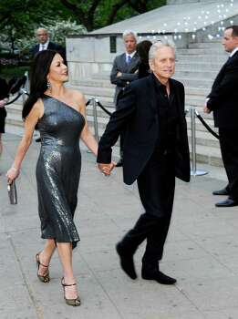 Actors Catherine Zeta-Jones and Michael Douglas attend the Vanity Fair Tribeca Film Festival party at the State Supreme Courthouse on Tuesday, April 17, 2012 in New York. Photo: Evan Agostini, AP / AGOEV