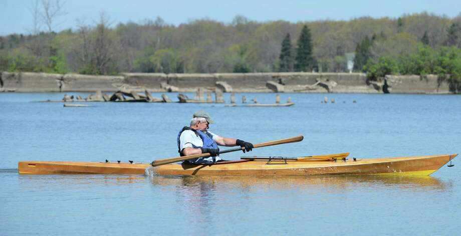 Tom O'Donnell of Schenectady paddles a 17-foot wooden kayak that he built himself on the Mohawk River near Lock 7 in Niskayuna Thursday April 19, 2012.(John Carl D'Annibale / Times Union) Photo: John Carl D'Annibale, Albany Times Union / 0420_weather 01