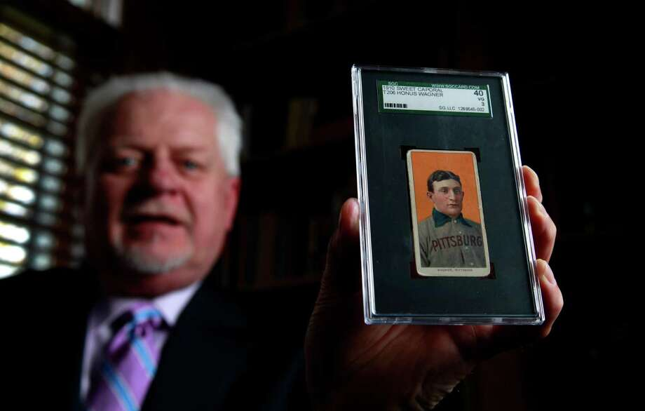 A New Jersey man, whose name has not been released, made the winning bid of $1.2 million for a rare Honus Wagner baseball card in an online auction that ended Friday, April 20. Bill Goodwin, above, is a Missouri  collectibles dealer who auctioned off the card for a Houston seller. Photo: Jeff Roberson, Associated Press / AP2012