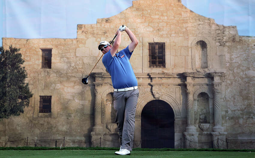Marc Leishman tees off in front of an Alamo mural at the 18 hole during the Oak Farms Dairy Pro-Am at the TPC Oaks Course on April 18, 2012 in advance of the Texas Open.