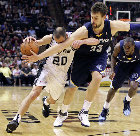The San Antonio Spurs' Manu Ginobili is fouled by the Memphis Grizzlies' Marc Gasol as Memphis Grizzlies' Quincy Pondexter watches during second half action Thursday April 12,  2012 at the AT&T Center. The Spurs won 107-97. Photo: EDWARD A. ORNELAS, SAN ANTONIO EXPRESS-NEWS / © SAN ANTONIO EXPRESS-NEWS (NFS)